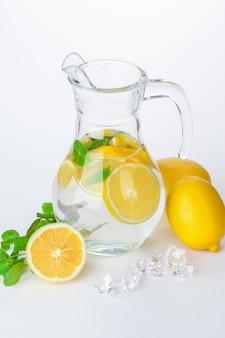 Jug of lemonade isolated on white