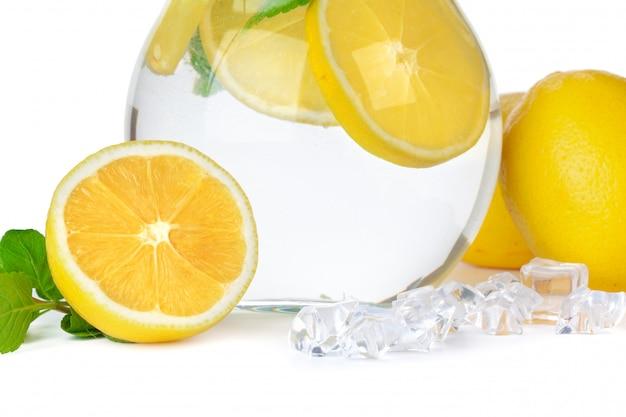 Jug of lemonade on white background