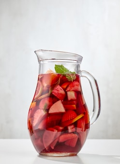 Jug of red sangria on white restaurant table