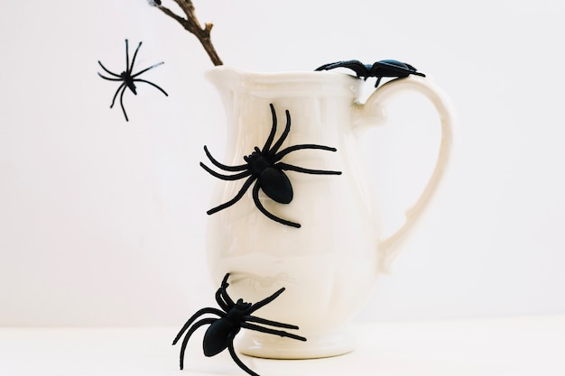 Jug with fake spiders