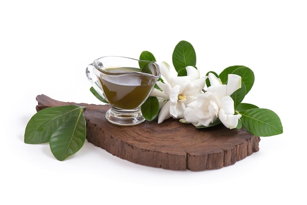 Juice extracted from cape jasmine flowers placed isolated on a white.