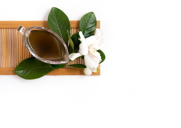 Juice extracted from cape jasmine flowers placed isolated on a white