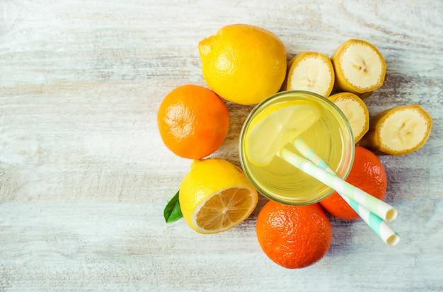Juice fresh lemon orange apple banana. selective focus.