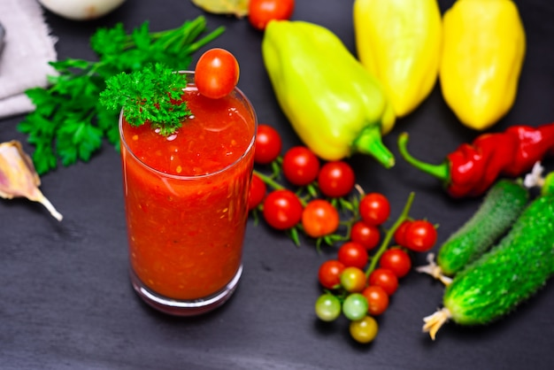Juice from a red tomato in a glass