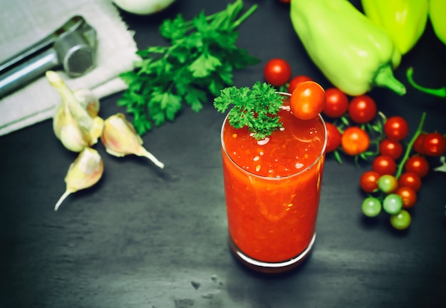 Juice from a tomato and spices in a glass