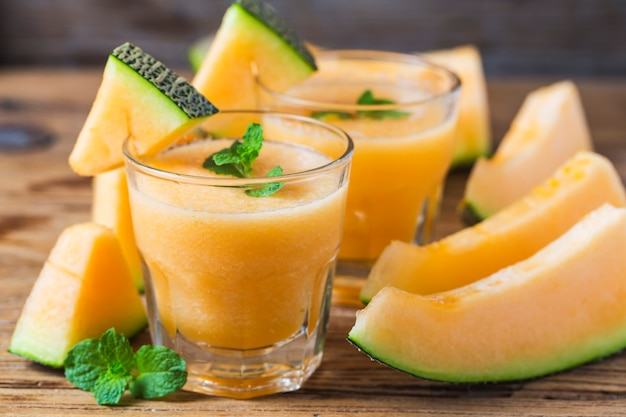The juice of melon with mint in a glass jar on the table.hami melon