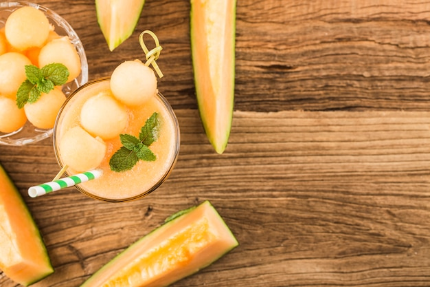 The juice of melon with mint in a glass on the table.hami melon