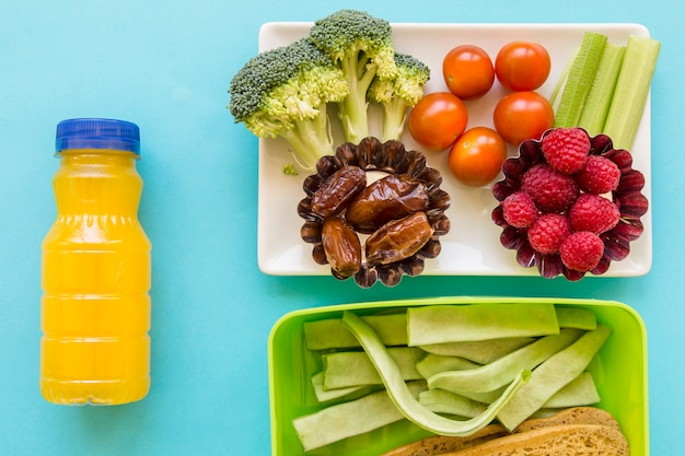Juice near healthy food and lunchbox