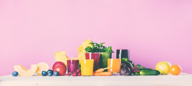 Juices smoothie different glasses health concept