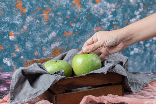 Juicy apples in a rustic wooden tray