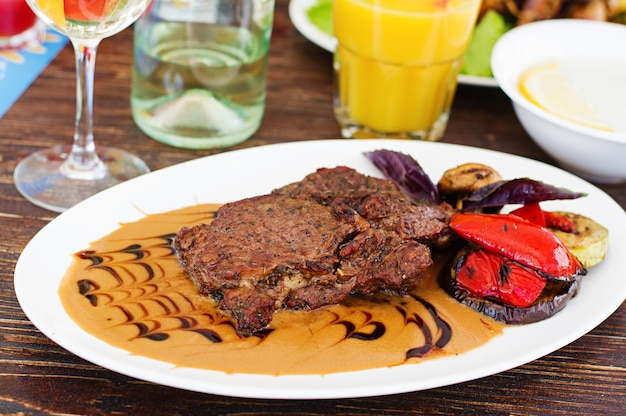 Juicy beef steak with french cream sauce