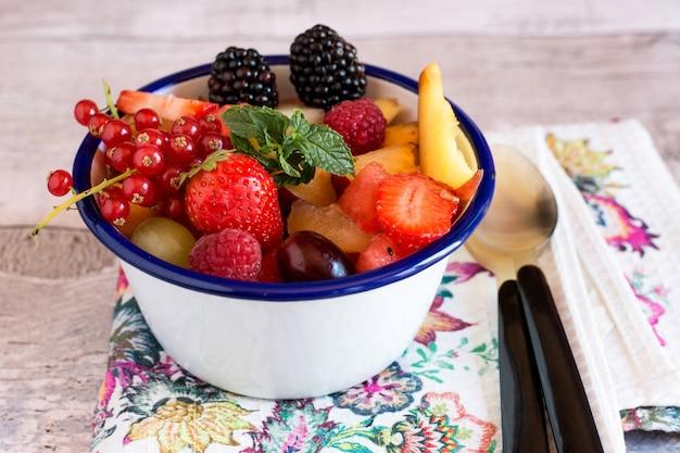 Juicy berries and fruit in bowl