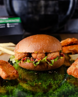 Juicy burger with chicken nuggets in batter