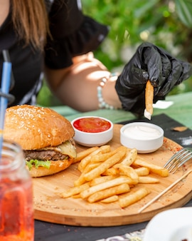 Juicy burger with french fries ketchup and mayonnaise