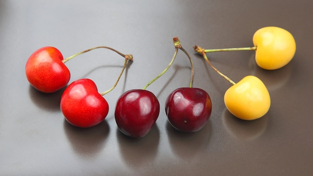 Juicy cherry berry on a gray background. fruits and vitamins. healthy food for breakfast. fruits of vegetation. fruit dessert