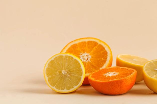 Juicy citrus fruits on beige