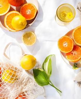 Juicy citrus fruits on white
