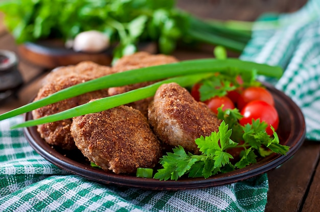 Juicy delicious meat cutlets on a wooden table in a rustic style