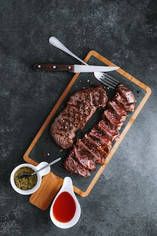 Juicy fresh fried steaks for dinner. two fried striploin steak in a medium roasting rare