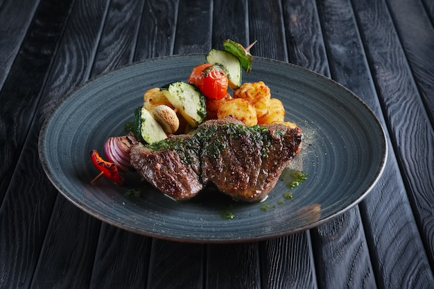 Juicy grilled beef fillet with potato, mushroom, zucchini, tomato, pepper and red onion on wooden skewer