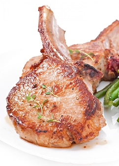 Juicy grilled pork fillet steak with green beans