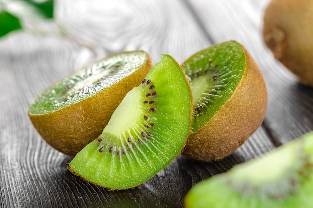 Juicy kiwi fruit on wooden table