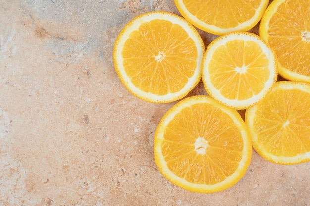 Juicy orange slices on marble background. high quality photo