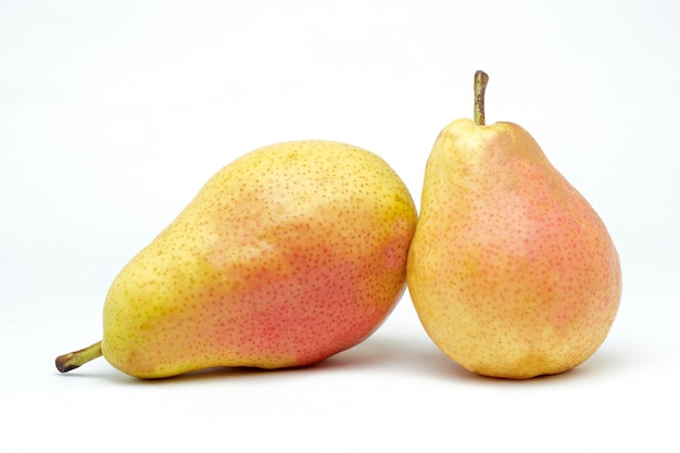 Juicy pears on a white surface
