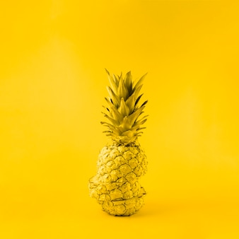 Juicy pineapple on yellow background