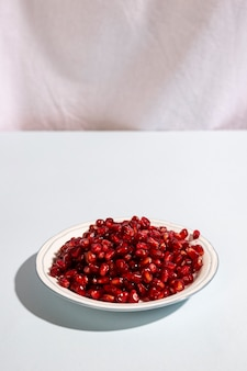 Juicy pomegranate seeds on plate