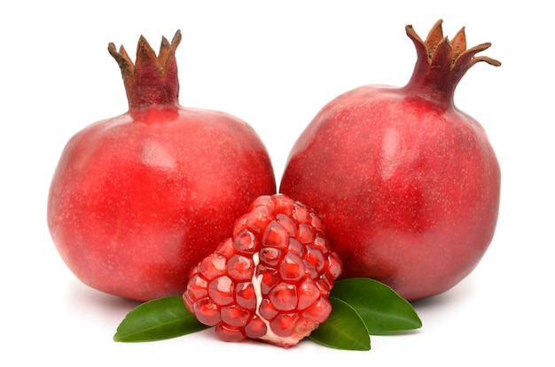 Juicy pomegranate on white surface