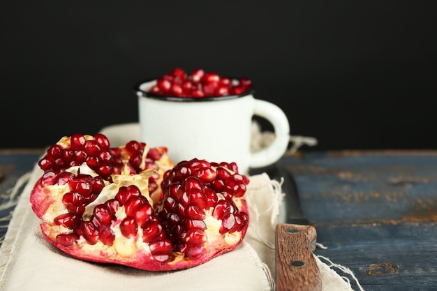 Juicy ripe pomegranate on wooden table