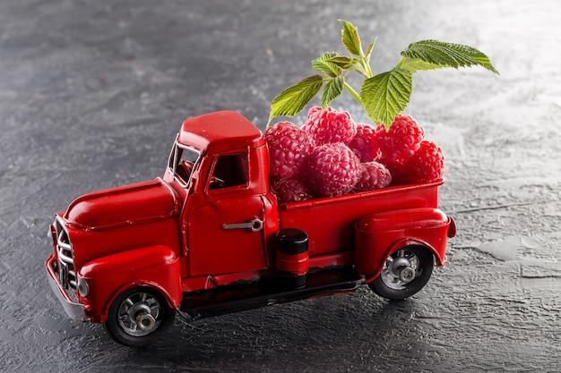 Juicy ripe raspberry on the car model