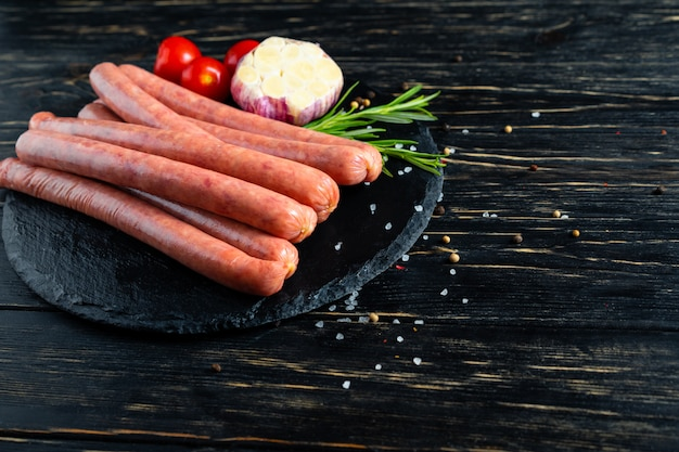 Juicy sausages with rosemary and spices on the table