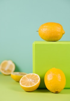 Juicy seasonal lemons on a bright colored background, close up