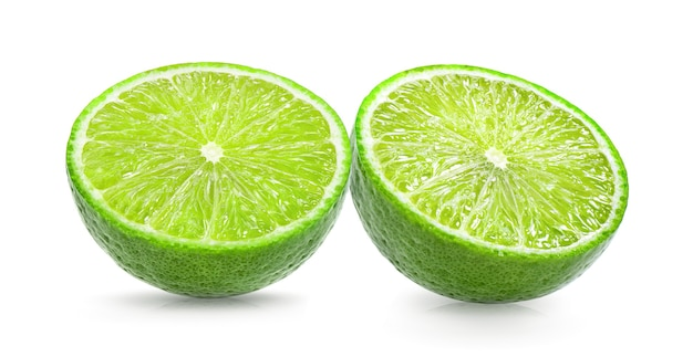 Juicy slice of lime isolated on white surface