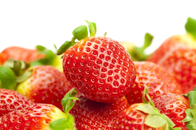 Juicy strawberries isolated on white
