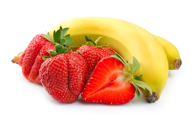 Juicy strawberry with banana on white close up