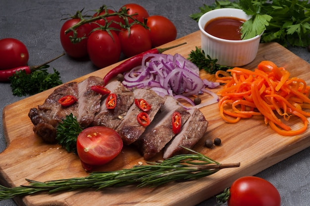 Juicy suvide pork steak with hot pepper and tomato sauce
