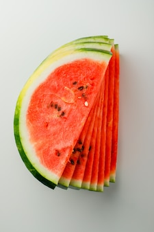 Juicy watermelon slices on a white background.