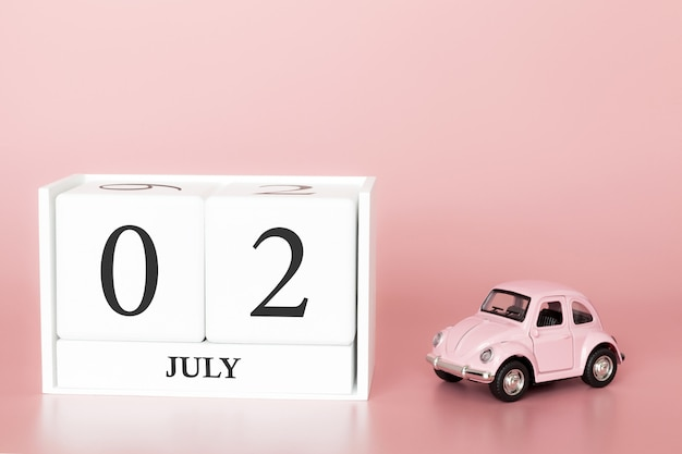 July 02nd, day 2 of month, calendar cube on modern pink background with car