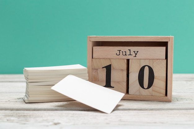 July 10th. image of july 10, calendar on wooden. summer time