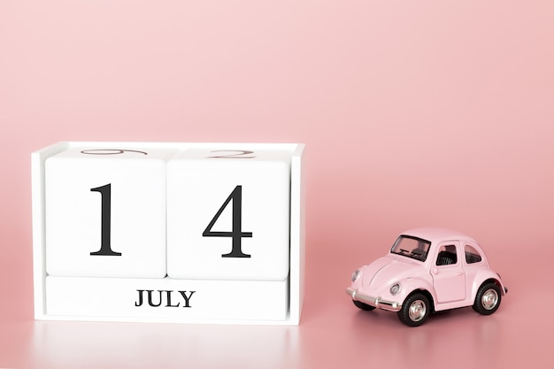 July 14th, day 14 of month, calendar cube on modern pink background with car