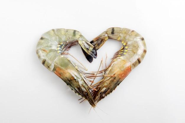 Jumbo raw shrimp form the symbol of love