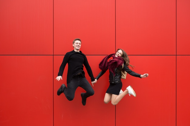 Jump. a man and a woman on a red background.