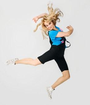 Jumping blond girl