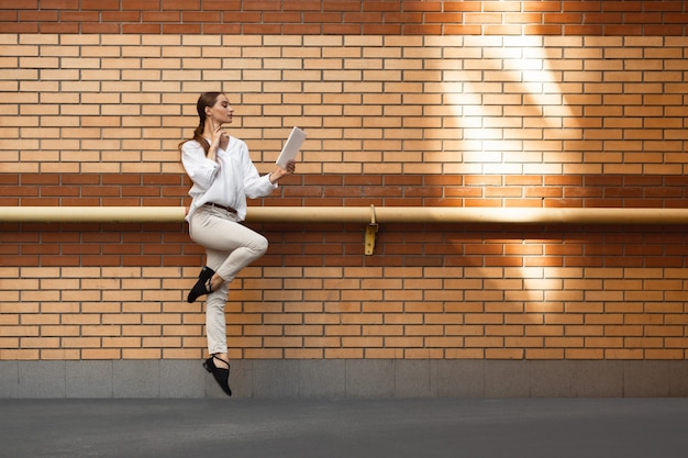 Jumping woman in the city, ballet dancer