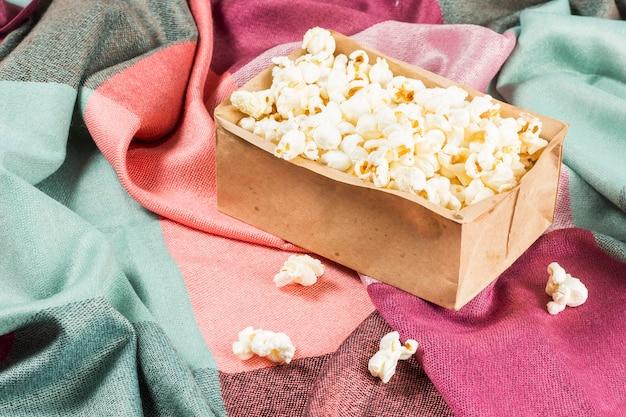 June celebration. popcorn on a colored fabric.