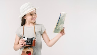 Junior traveler with map and camera