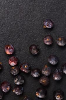 Juniper berries macro detail closeup on black